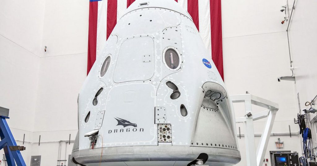 NASA units date for SpaceX's first passenger flight on Group Dragon