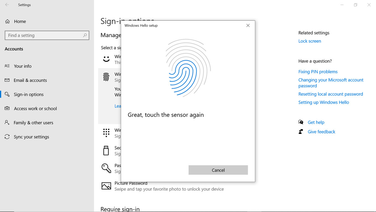 An image of a fingerprint, which is highlighted in blue as the fingerprint is captured.