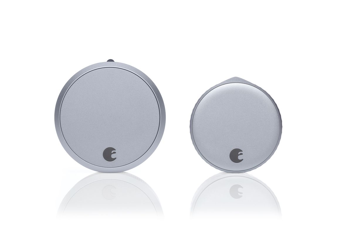 An August Smart Lock Pro next to an August Wi-Fi Smart Lock on a white background