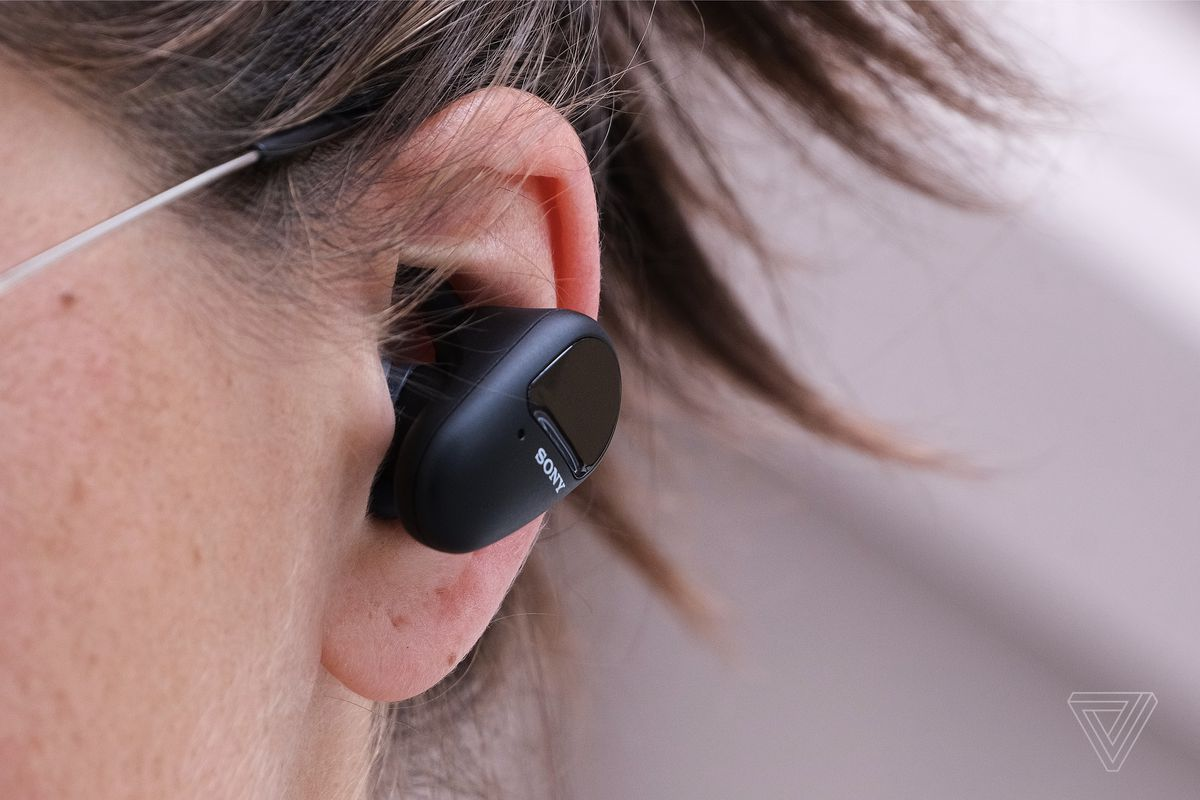 A close-up image of a Sony's SP-800N earbuds in someone's ear.