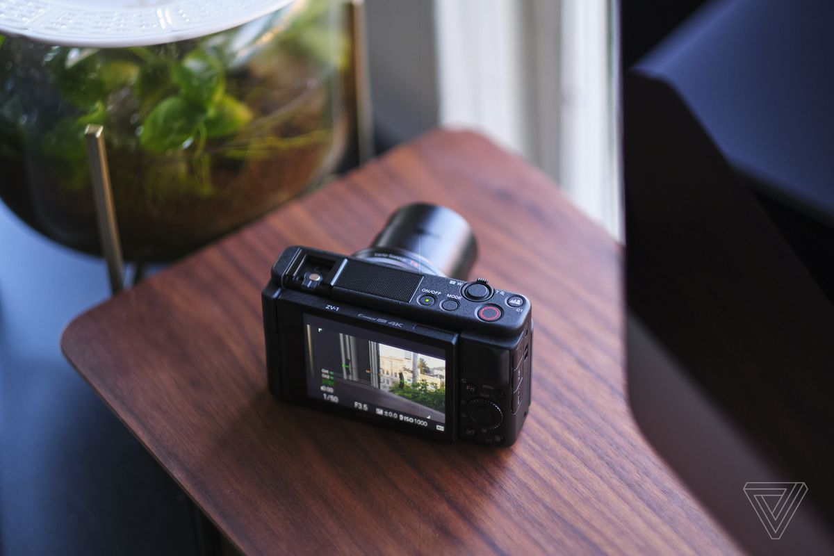 The Sony ZV-1 has a fully articulating screen and the lens is 24-70mm full frame equivalent.