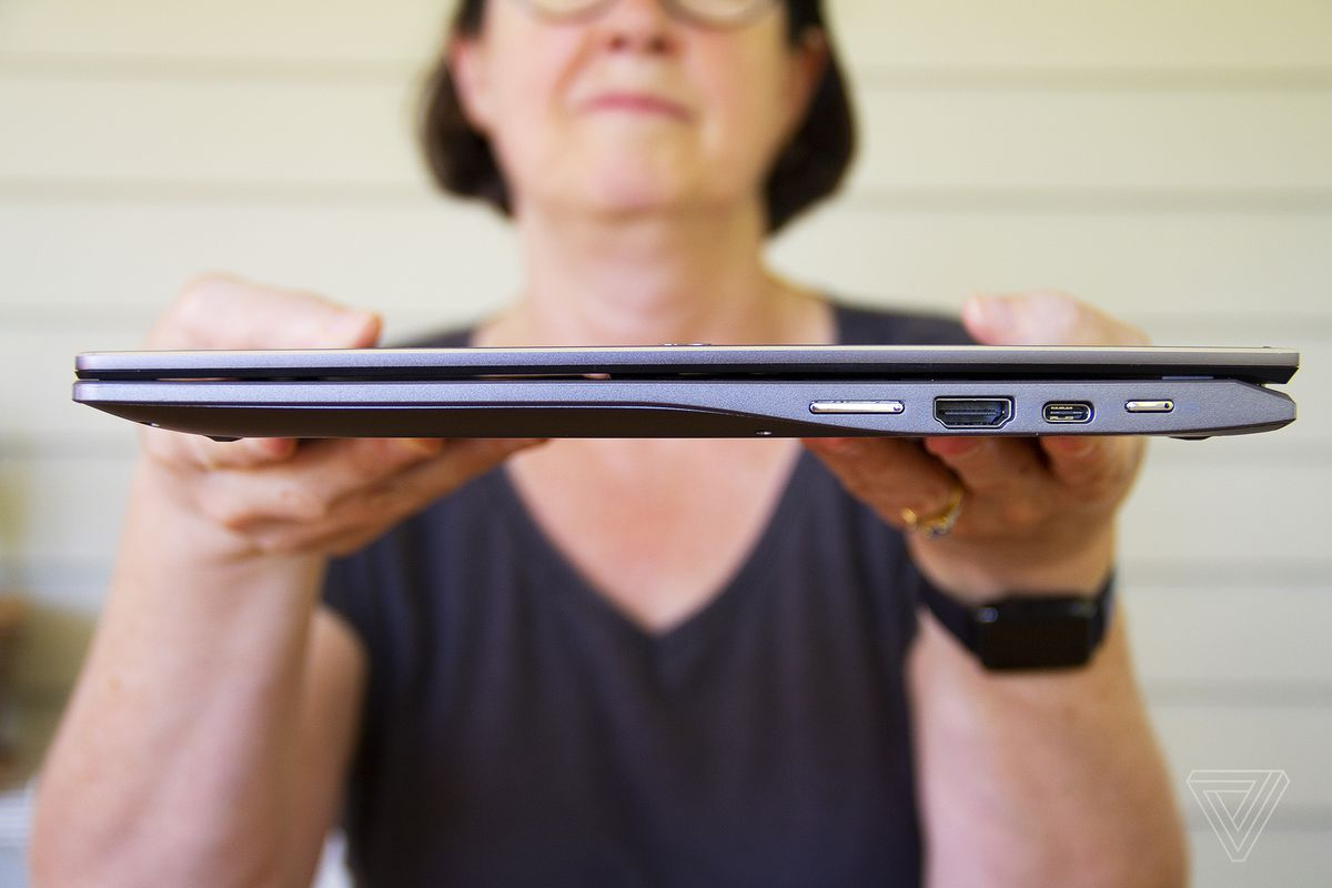 A user holds up the Acer Chromebook Spin 713 facing the right.