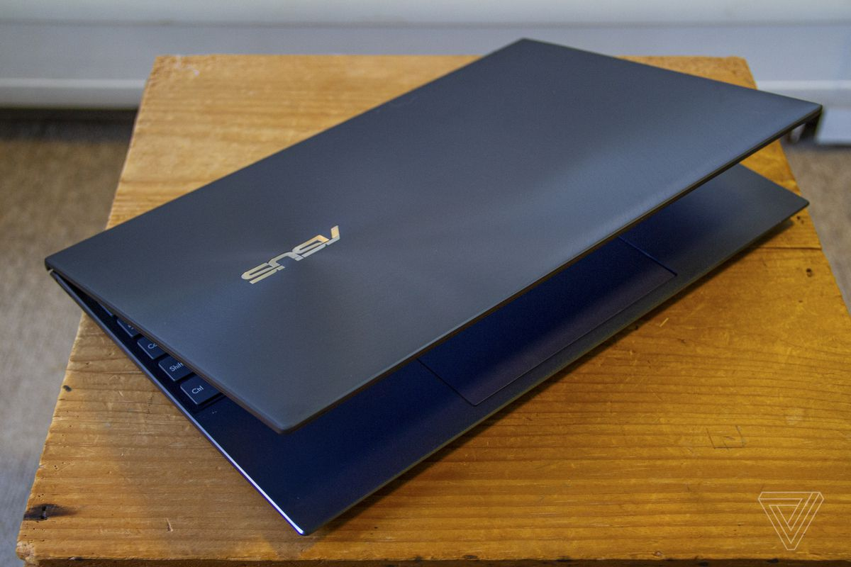 The Asus Zenbook 14 half closed from above.