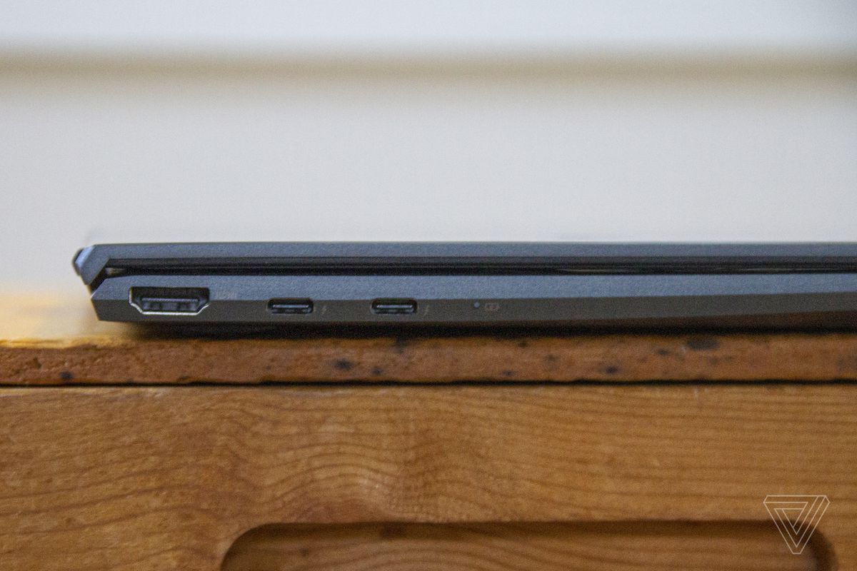 The Asus Zenbook 14 closed from the left side.