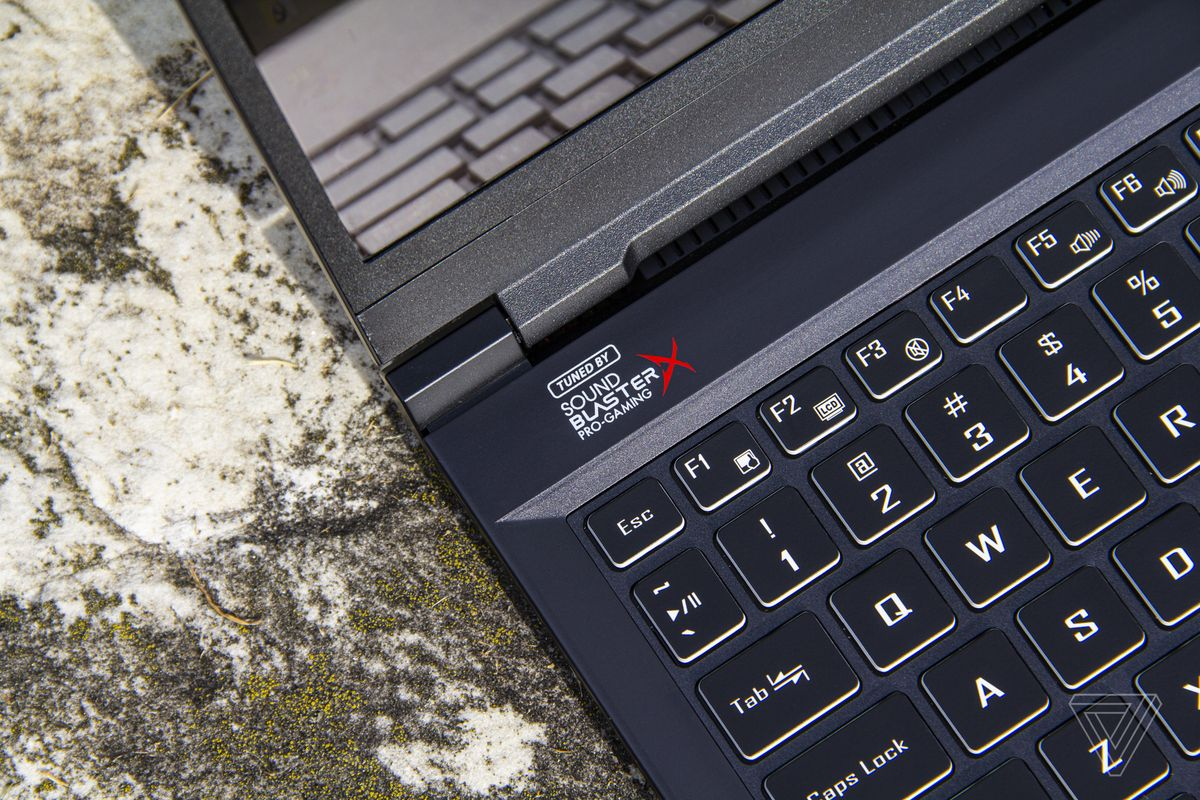 The Sound Blaster Pro-Gaming logo on the left corner of the Origin EVO15-S keyboard deck, up close.